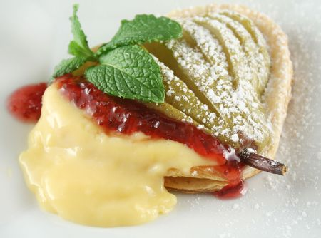 rich flavor: Delicate pear tartlets with custard and strawberry jam.