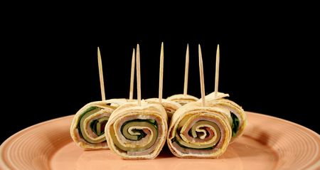 unprocessed: Bite size roll ups with ham, cheese and spinach. Stock Photo
