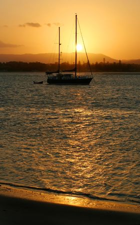 Yacht by the golden seashore at sunset. Stock Photo - 2361758