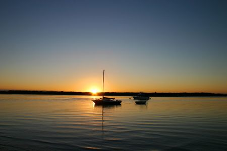 Boats bathed in the still of morning sunrise light Stock Photo - 2400141