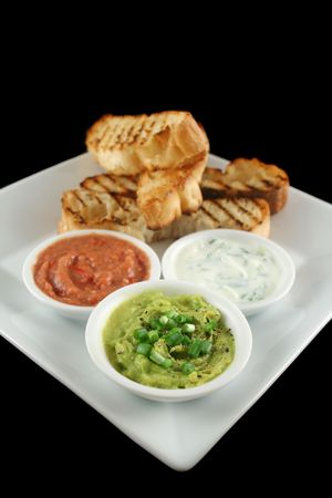 turkish bread: Delicious and colorful trio of dips with grilled Turkish bread.
