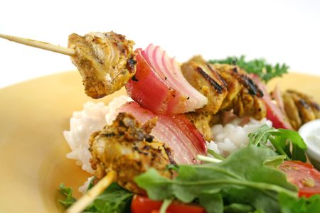 Chicken tandoori skewers with minted yogurt and a rocket salad.
