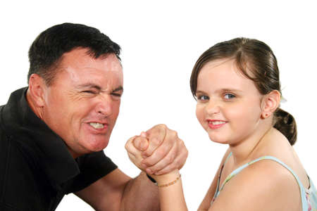 girl bonding: Father and young daughter playing around arm wrestling.