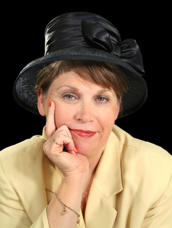 contented: Contented middle aged woman in a black hat. Stock Photo