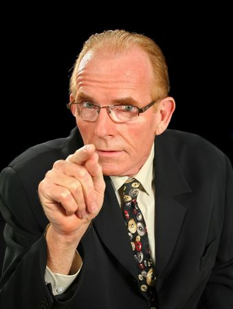 staunch: Middle aged businessman pointing in an intimidating manner. Stock Photo