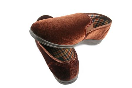 snug: A pair of warm and comfy mens slippers.