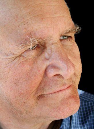 craggy: Three quarter profile of a craggy looking senior man. Stock Photo