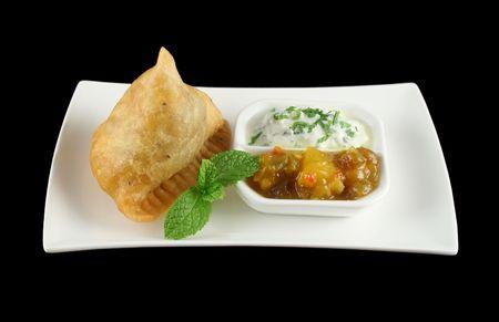 samosa: Indian samosa with mango chutney and herb yogurt.