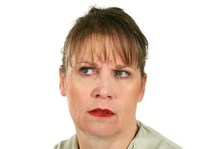 incensed: Middle aged female looking away with a frown.