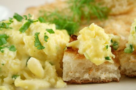 turkish bread: Scrambled eggs on turkish bread with shallots fennel and parsley.