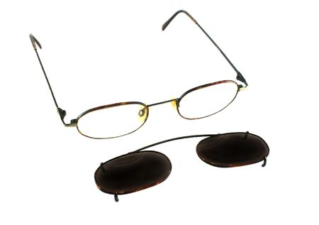 bifocals: Old fashioned clip on sunglasses with frames.