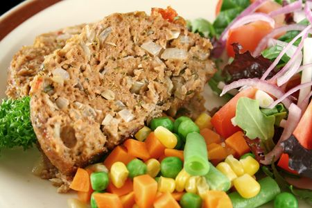 meatloaf: Homestyle lamb meatloaf with vegetables and salad.