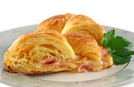 Hot melted cheese and ham croissant ready to serve.