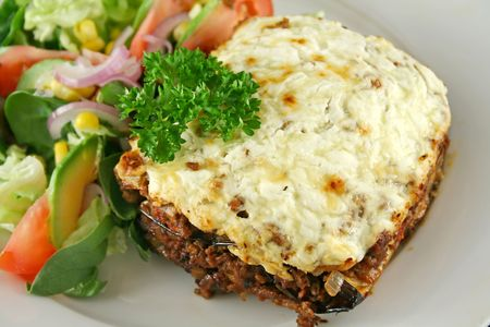 egg plant: Lamb moussaka with egg plant cheese and salad. Stock Photo