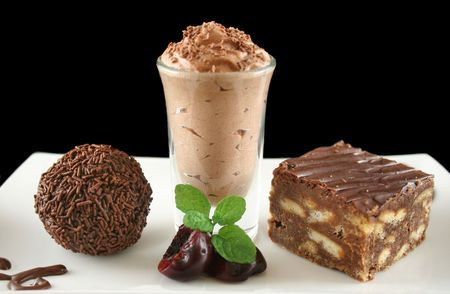 Triple chocolate treat of a rum ball and chocolate mousse and slice. Stock Photo - 2657183