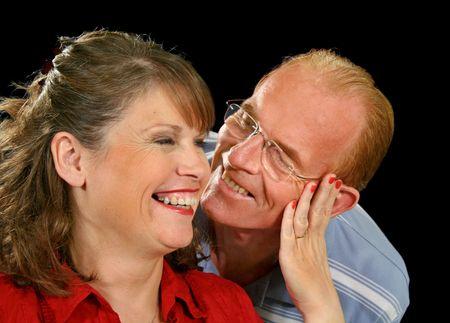 kinship: Middle aged couple playing around having fun. Stock Photo