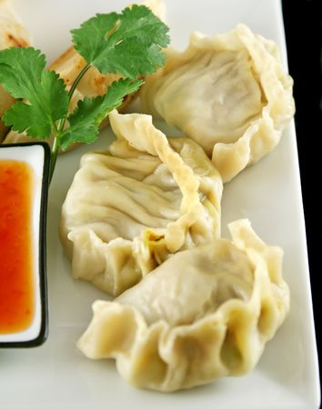 delectable: Delicious fried pork and vegetable Chinese dumplings ready to serve.