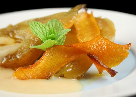 zest: Pears poached in juice with orange zest and caramel custard.