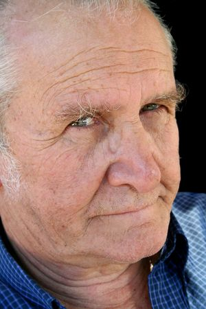 wrinkled brow: Craggy senior male staring down the barrel. Stock Photo