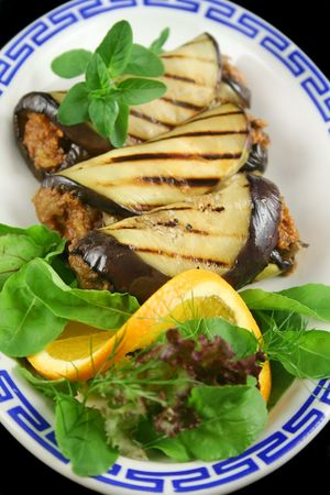 egg plant: Chargrilled egg plant and beef rolls with an orange and fennel salad. Stock Photo
