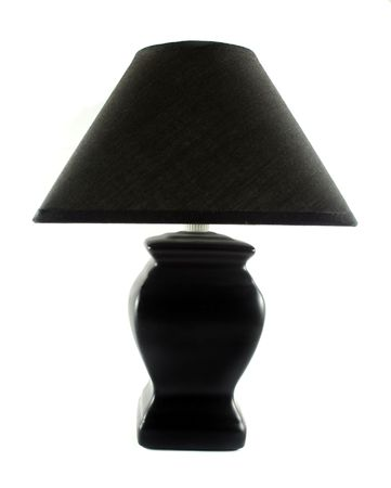 soft diffused light: Black table lamp with triangular lamp shade. Stock Photo