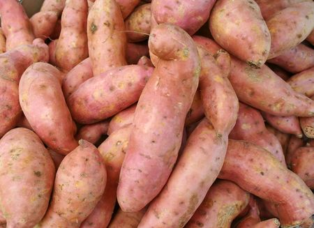 Fresh sweet potatoes on sale at the markets.