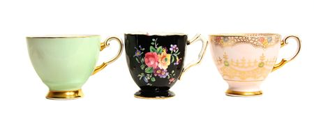 collectibles: Three antique teacups lined up in a row.