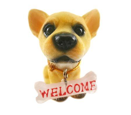 grosse tete: Cute c�ramique chien avec de grandes t�te et signe.