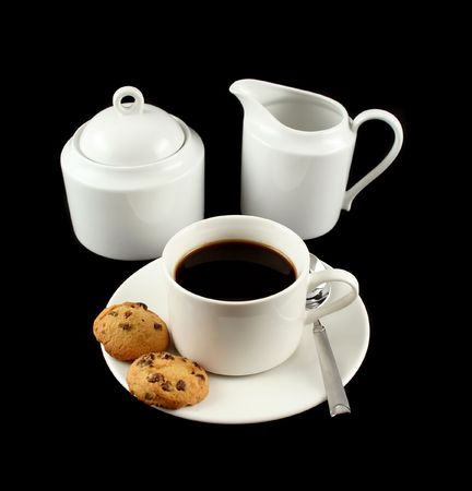rich flavor: Cup of black coffee with sugar and milk with chocolate chip cookies.