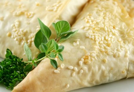 filo pastry: Background of baked filo pastry spinach and feta parcels.