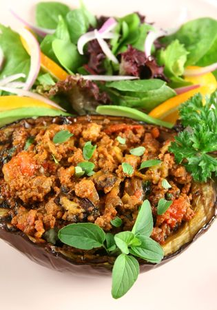 egg plant: Egg plant stuffed with bolognaise with side salad and garnish. Stock Photo