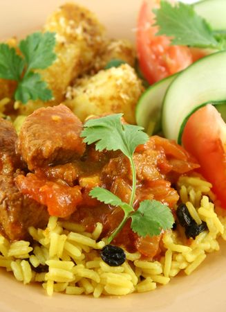 side of beef: Beef vindaloo curry on tumeric rice with a side salad.