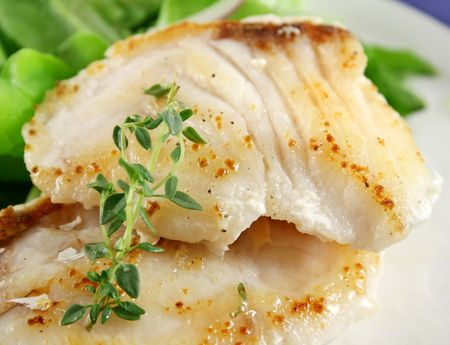 on perch: Background of pan fried Pearl Perch with and salad.
