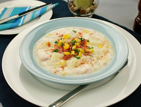 freshly prepared: Freshly prepared ham corn and potato chowder with paprika ready to serve.