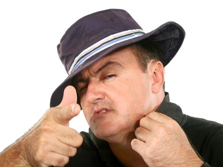 self conceit: Confident man in hat looking at camera and pointing.