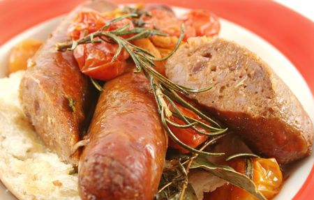healthful: Delicious beef sausage and cherry tomato bake with rosemary.