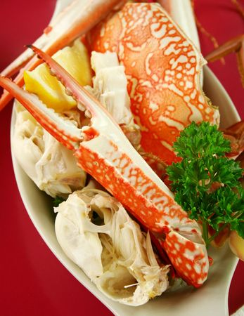 blue swimmer crab: Cracked sand crab with lemon ready to serve. Stock Photo