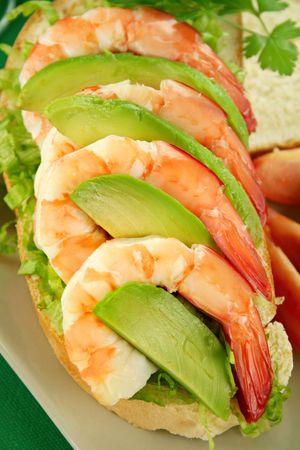 Delightful fresh shrimp and avocado open sandwich ready to serve. photo