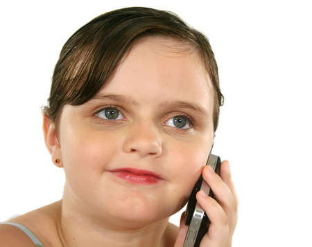 look after: Little girl with a happy look after listening on her cell phone.