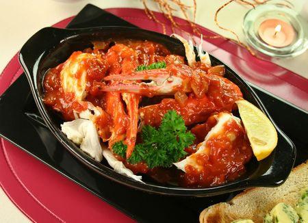 blue swimmer crab: Delicious fresh cracked sand crab in a spicy tomato sauce with toast and herb butter.
