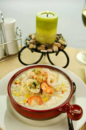 Delicious thick and creamy seafood chowder with a variety of seafood. photo
