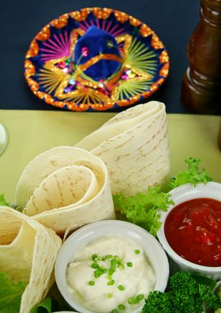 tortillas: Mexican vegetarian platter with tortillas, sour cream and tomato salsa,