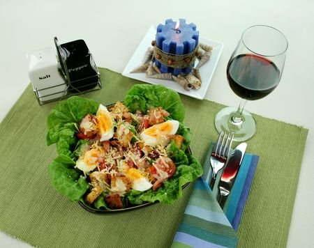 redwine: Fresh Caesar salad with lettuce, cherry tomatoes, parmesan cheese, egg, bacon and croutons. Stock Photo
