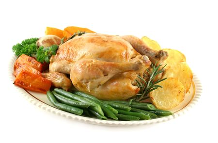 nourishment: Whole roast chicken with potatoes pumpkin carrots and beans.
