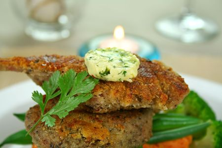 Crumbed lamb cutlets on green beans with herb butter and coriander. Stock Photo - 3536956