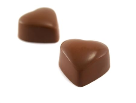 hard love: Two delicious and symbolic heart shaped chocolates.