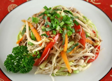 Stirfry beef chow mein with fresh Chinese vegetables. photo