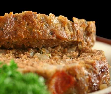 meatloaf: Home style lamb meatloaf with salad ready to serve. Stock Photo