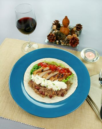redwine: Open chicken tortilla with refried beans, guacamole and sour cream with chives. Stock Photo