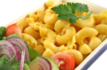 Macaroni cheese and a fresh red onion garden salad ready to serve.